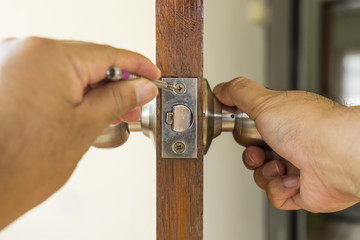 close-up locksmith repair on wood door - can use to display or montage on product