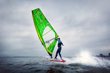 Freestyle windsurfer does a trick on the lagoon