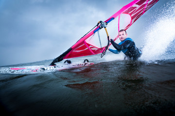 body drag stunt by a professional freestyle windsurfer