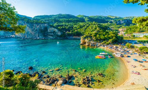 Wall mural Beautiful beach and boat in Paleokastritsa, Corfu island, Greece