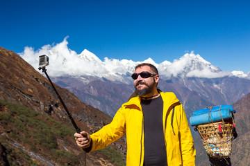 Man taking self portrait during mountain trekking