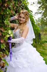 Wedding bouquet in hand charming bride.