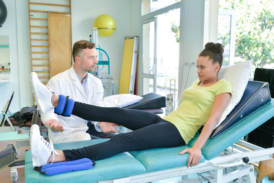 Lady doing leg exercises with therapist