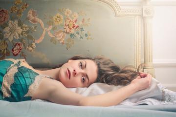 Sensual woman lying in bed