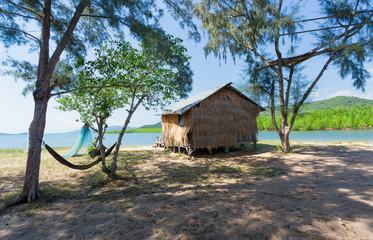 wooden house along the lush riverside