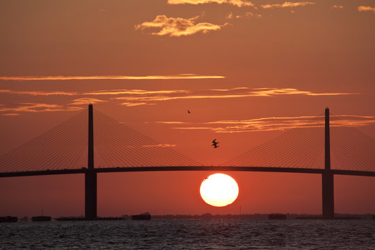 Sunrise behind the Sunshine Skyway bridge linking Tampa St. Petersburg, Fl to Sarasota across Tampa Bay.