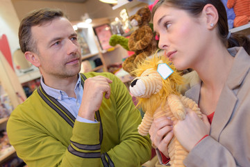 parents-to-be shopping choosing plush for their kid