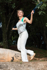 Physically Fit Woman Jump Roping Outdoors