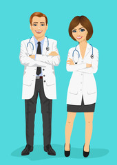 male and female doctors standing with arms folded