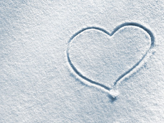 Closeup symbol of heart on the background of fresh snow texture in blue tone. Merry Christmas or Valentine's Day Concept. Top view, high resolution product