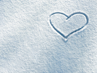 Drawing of heart on the background of fresh snow texture in blue tone.  Merry Christmas or Valentine's Day Concept. Copy space, high resolution product