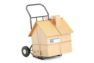 Household moving services concept. Hand truck with cardboard hou