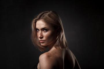 cinematic portrait of girl in dark studio