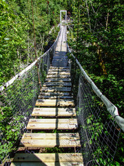 wooden bridge over deep gorge
