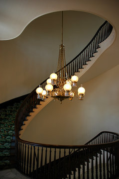 View of a Twisty Windy Staircase Wrapped Around a Chandelier