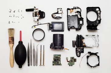 Camera part and tool for repair on white background with gradient filter,(Selective focus),Camera broken,Camera repair concept,Top view