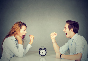 Man and woman mad angry with each other having disagreement screaming
