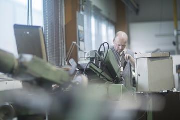 Man working in grinding workshop