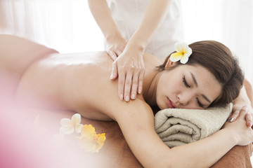 A beautiful woman is receiving a massage