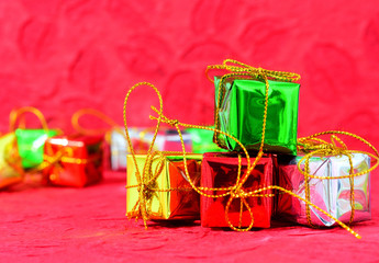 Christmas background with a red ornament, green gift box