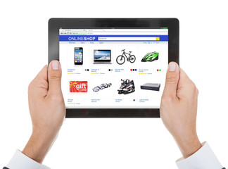 Person Shopping Online On Digital Tablet