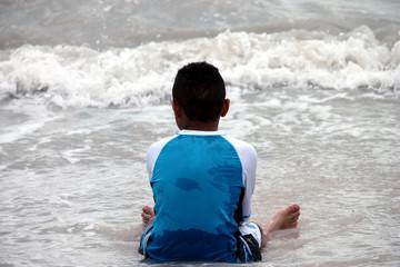 Fototapeta Ethnic Boy Sitting in the Water