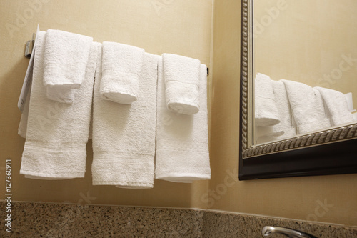 """""""hanging white towels inside bathroom of hotel"""" Stock ..."""