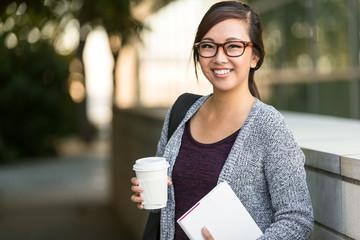 Smart intelligent grad student glasses confident happy at university hall walking to class