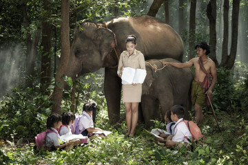 Teachers are teaching students to learn in natural classroom, Thailand.
