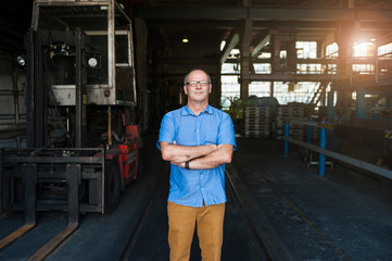 Portrait if man standing in factory