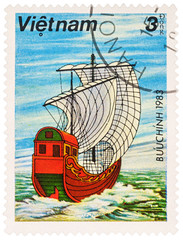 Old Asian sailing ship on postage stamp