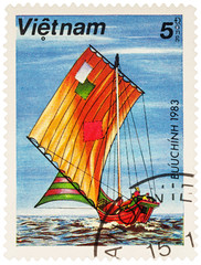 Old Asian sailing boat on postage stamp