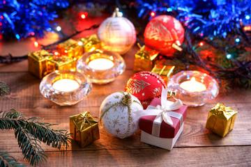 Christmas balls, gift boxes and candles