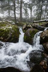 rocky waterfall in winter