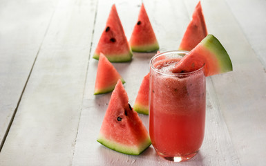 Wall Mural - watermelon juice on wood white background