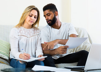 woman and black man with documents