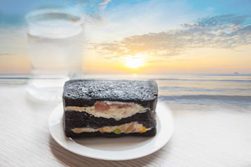 Charcoal sandwiches with sunrise on the beach.