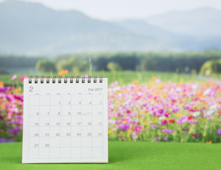 Year 2017 calendar with flower field background