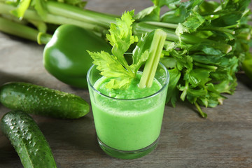 Glass of fresh vegetable smoothie on wooden table