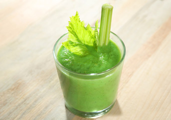 Glass of fresh vegetable smoothie on wooden background