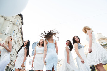 The future bride with girls stand in the center of town