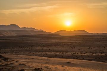 Sunset over the Wahiba Sands desert, Oman.