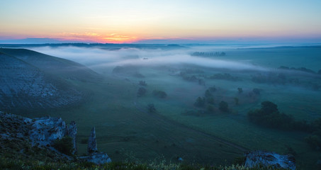 landscape of dense fog in the field at sunrise
