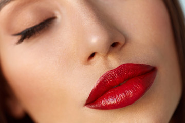 Beauty Woman Face With Beautiful Makeup And Sexy Red Lips