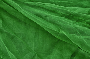 Close-up of plastic net. Artistic texture or background. Abstract plastic net texture. Background in dark green.