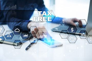 Businessman is working in office, pressing button on virtual screen and selecting tax free