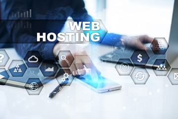 Businessman is working in office, pressing button on virtual screen and selecting web hosting