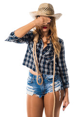 Sexy blonde woman cowgirl covering her eyes