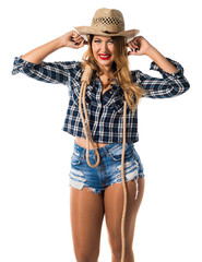 Sexy blonde woman cowgirl covering her ears