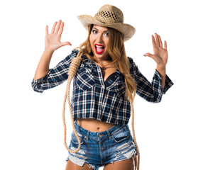 Sexy blonde woman cowgirl making surprise gesture